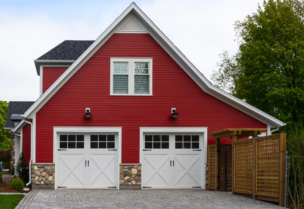 Garage Doors Designs according This Red Side Facing Garage Features Two Car Carriage Style Doors In White Wood