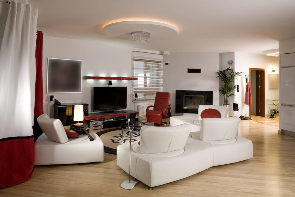 This Ultra Modern Space Includes Multiple White Living Room Sectional  Couches With Unique Rotating Backs