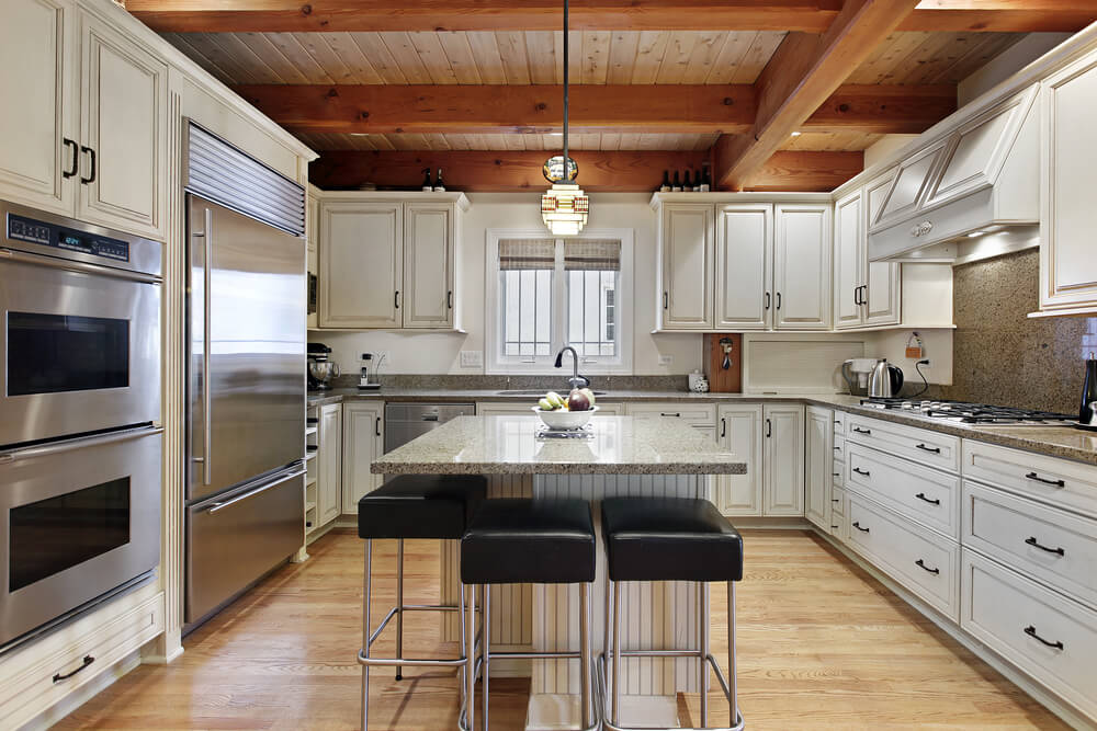 Kitchen Features Mixture Of Modern And Classic With Exposed Natural Wood Beams Over White Cabinetry