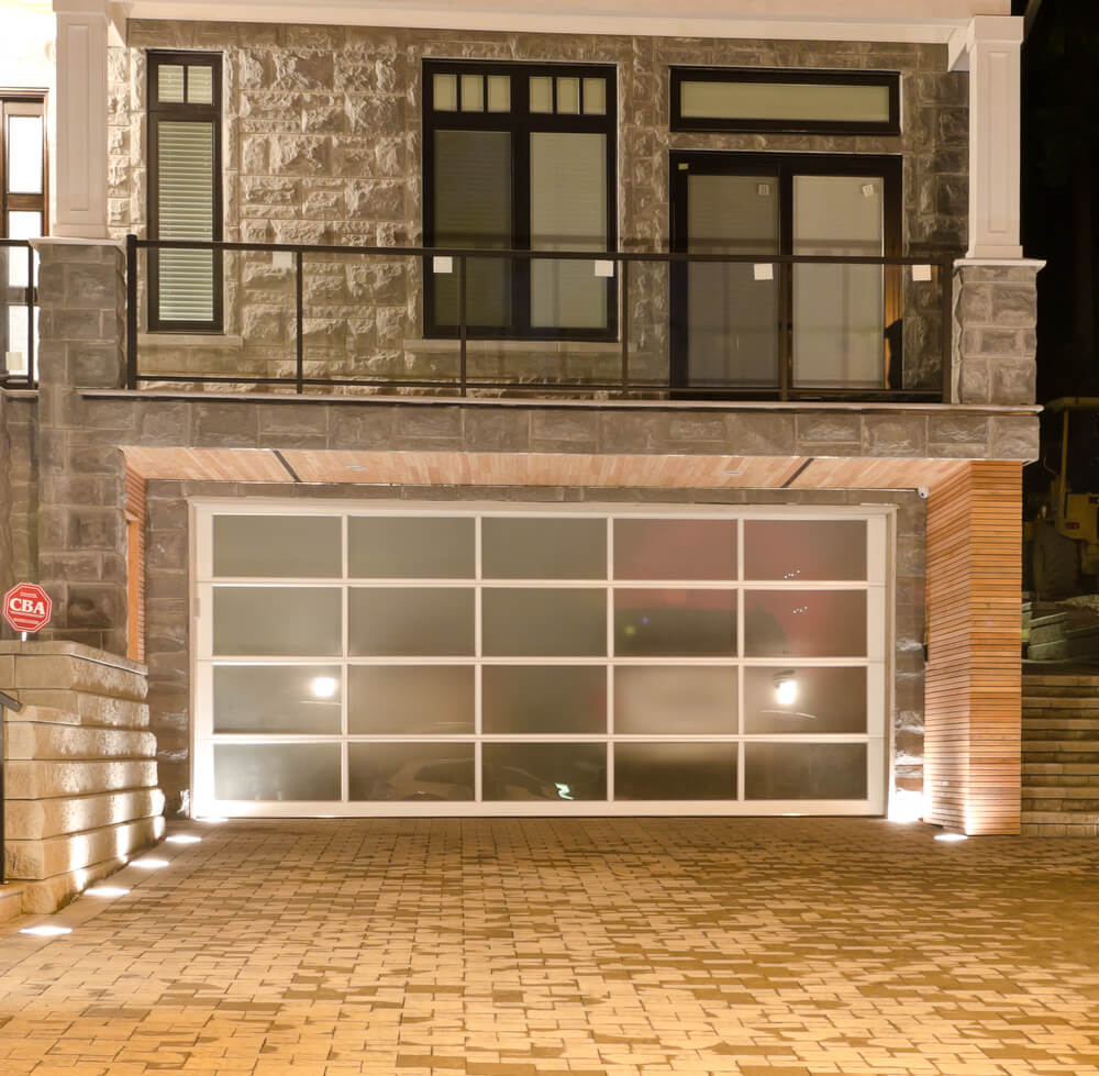 Garage Doors Designs pick a home you wish to fit your garage door on Large Brick Home Features Lower Level Two Car Garage With Single Large Smoked Glass Door