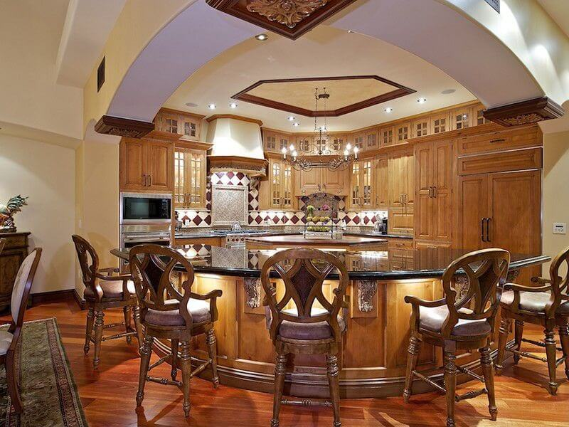 Truly Ornate Wraparound Island Features Under Counter Lighting And Expanse  Of Black Marble Countertop,