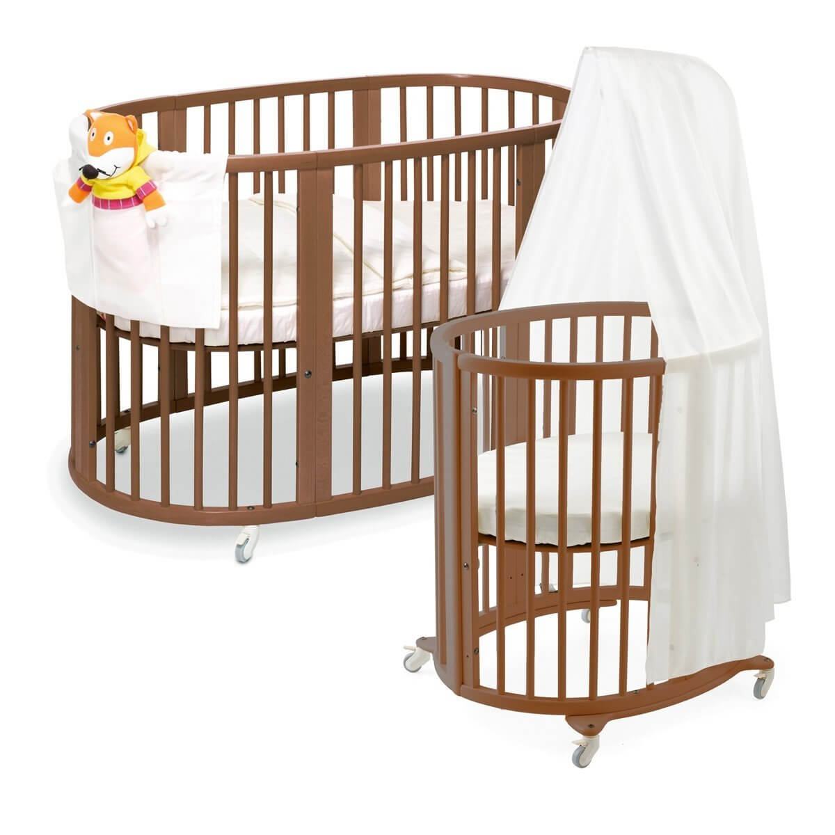 Crib for sale in olongapo - This Lengthy Oval Crib From Stokke Is Designed To Grow With Your Child Initial Circular
