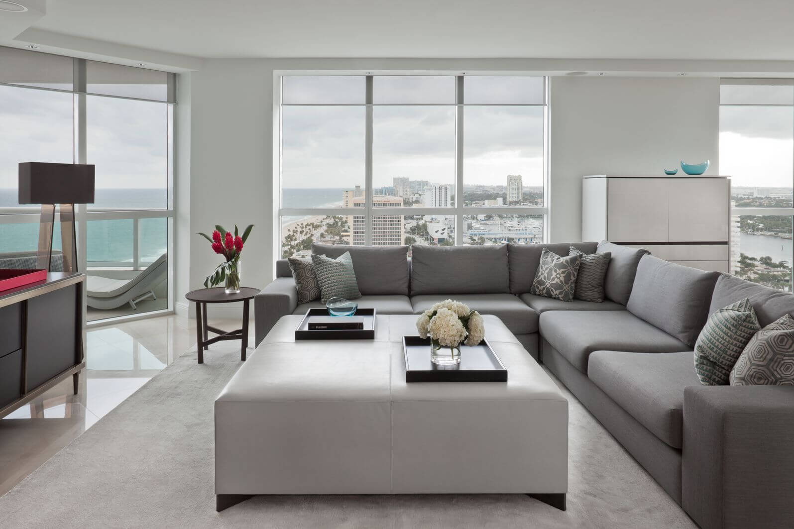 Elegant This Modern Living Room, Naturally Lit Via Floor To Ceiling Windows,  Features Immense White