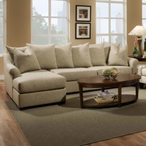 beige chaise lounge sectional with pillows
