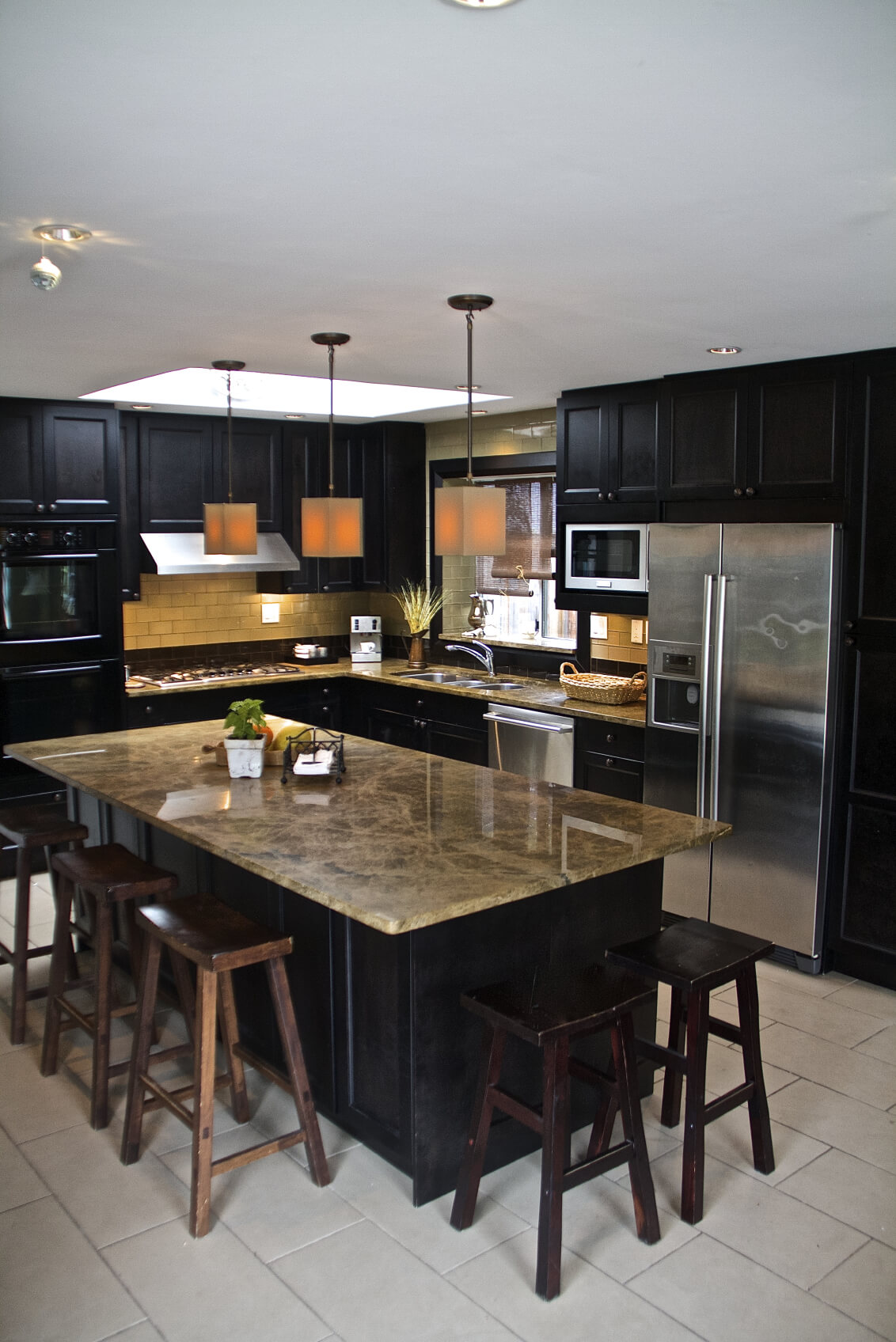 Contemporary Black L Shaped Kitchen With Long Island Set On White Tile  Floor.