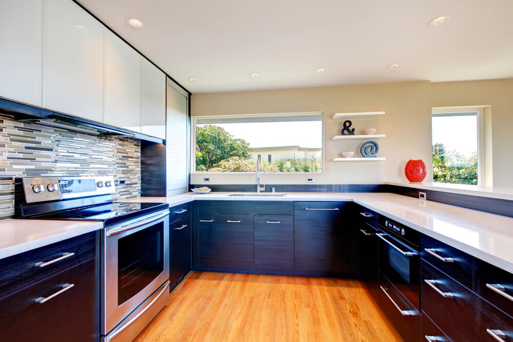 Large U Shaped Kitchen With Black Lower Cabinetry