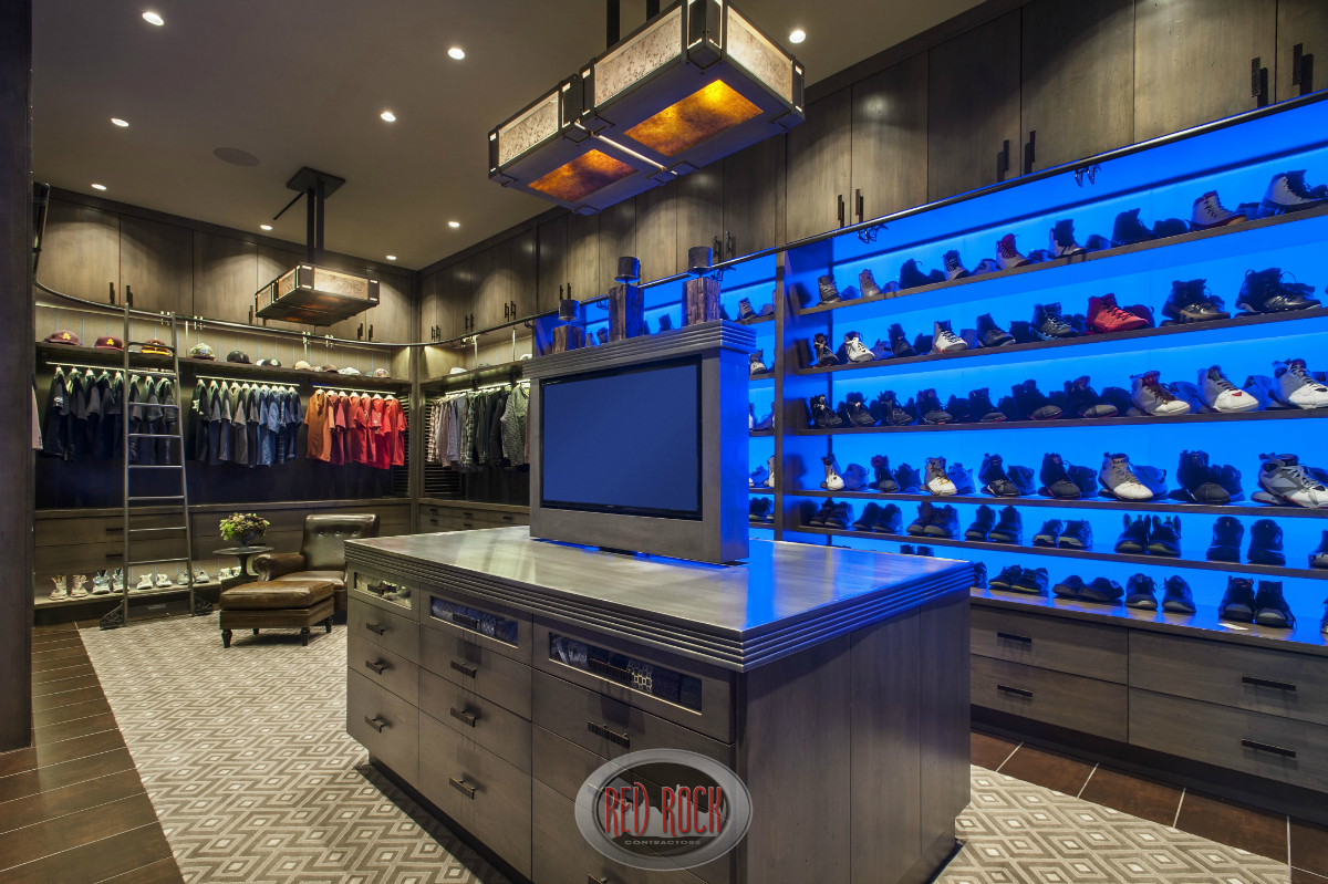 It's a one-of-a-kind luxury walk-in closet that does not lack for space or attention to detail. There is custom shoe storage, a large island serving as a dresser with a mounted flat screen television in the center.