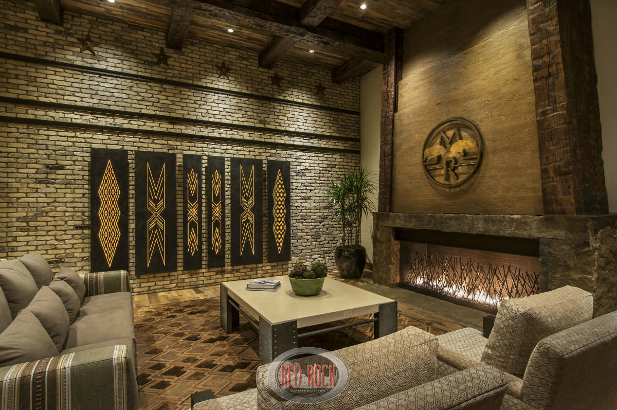 this view of the family room showcases the fabulous brick wall and wide fireplace - Rustic Interior Design Ideas
