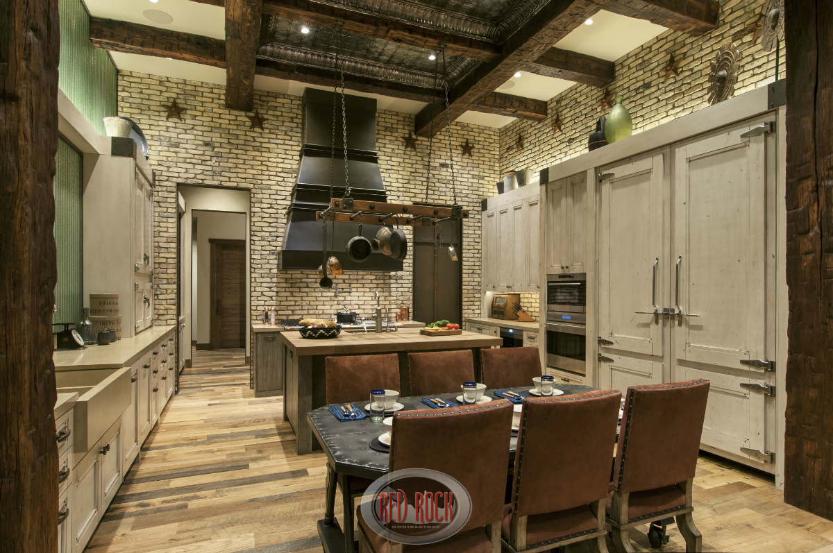 Rustic Kitchen Design With Natural Wood Flooring, Brick Walls And Custom  Cabinetry.