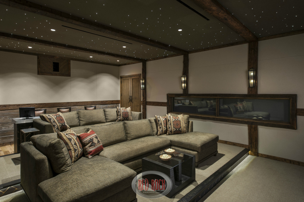 This seemingly identical photo of the home theater differs in that in this one the window is covered up for the ultimate movie-viewing experience.