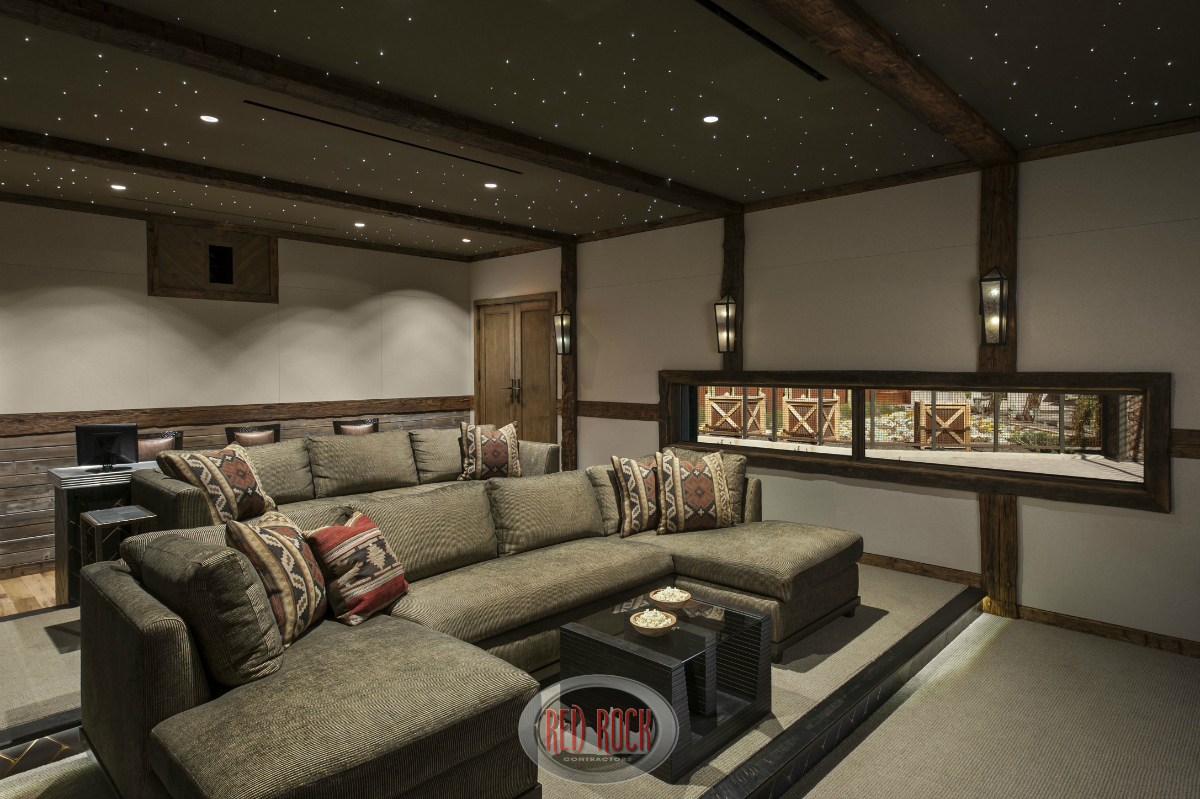 View Of The Luxury Home Theater Room From The Front Showcasing The Stadium  Seating Design Incorporating