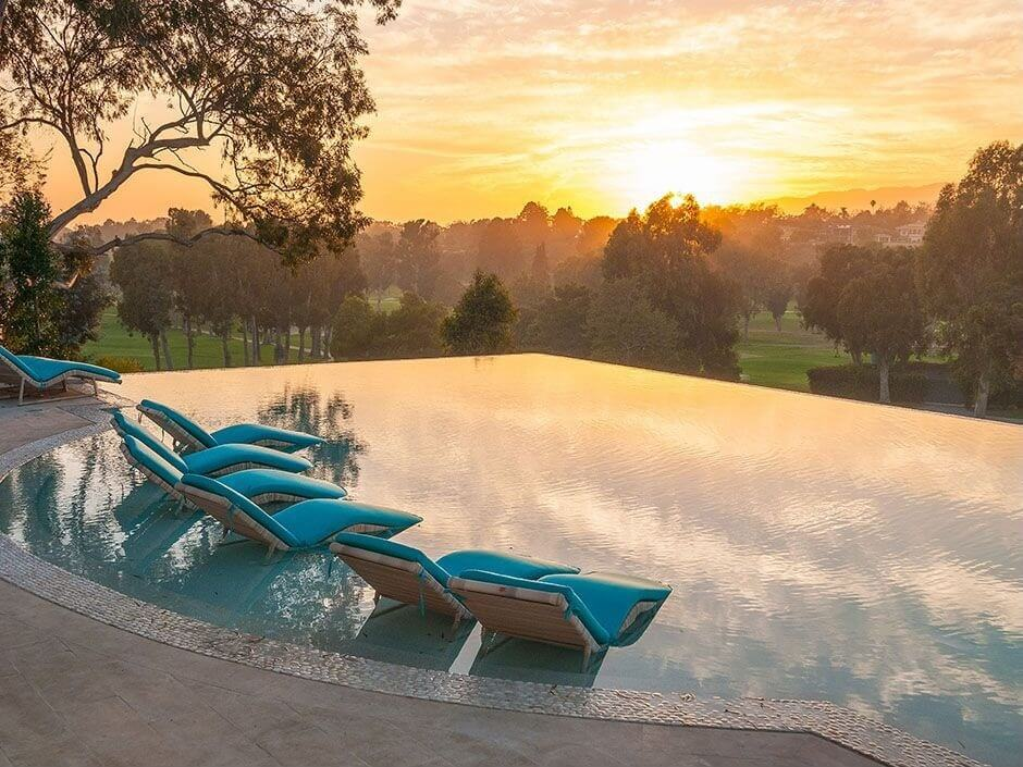 Here's a vista for which infinity pools are idea. It's hard to top a pool environment like this - an infinity pool perched up with an unobstructed view of the surrounding golf course.
