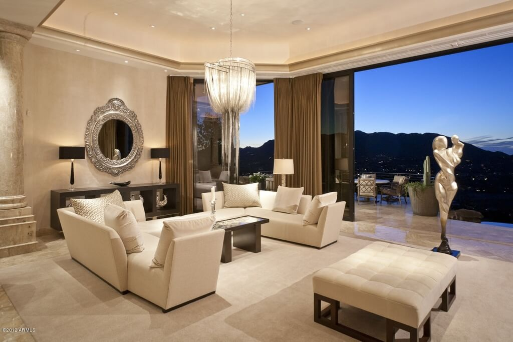 Elegant Beige Living Room Fully Opens To A Marble Decked Patio Space Via Sliding Glass Panels