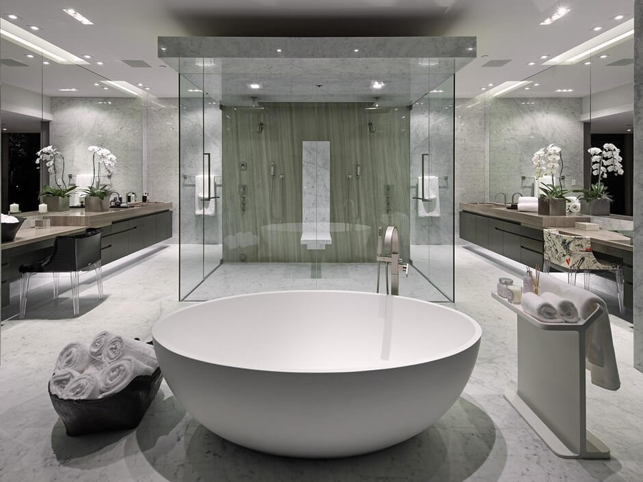 striking modern design bathroom centers acres of marble flooring and a pair of oversize natural wood