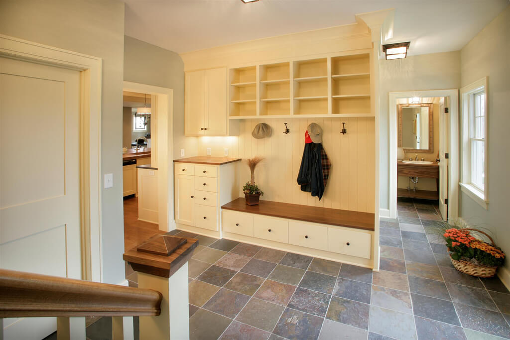 Built in cabinetry, bench, cubby holes, and drawers under the bench ...