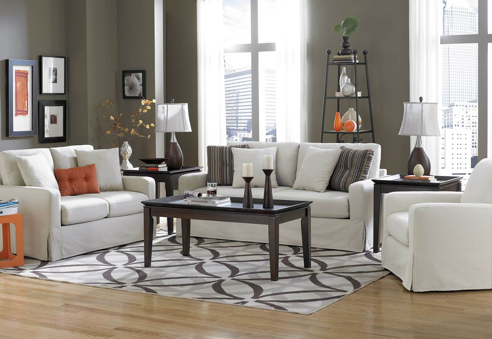 This modern living room adds a bright pop of orange as an accent color. The