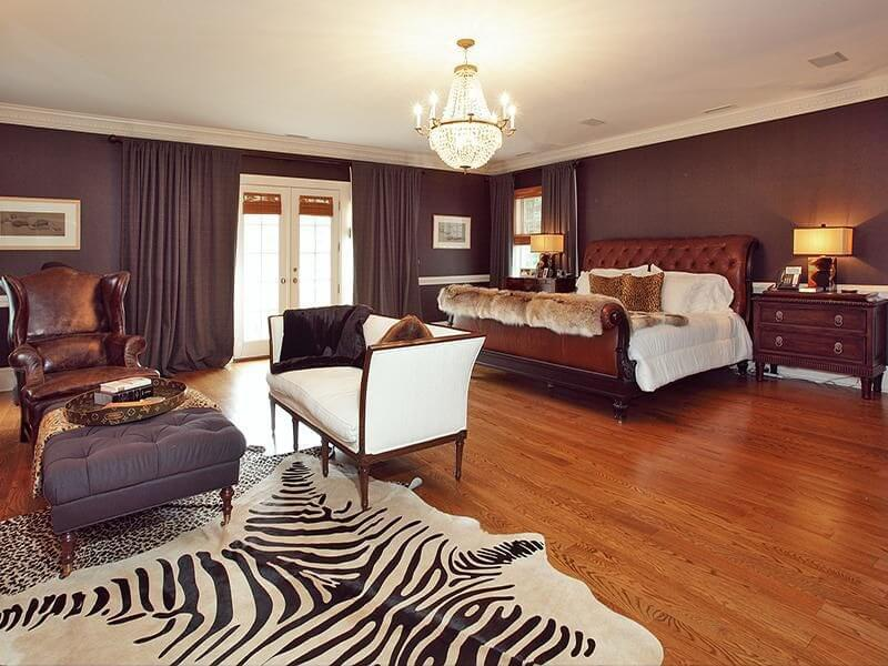 this spacious bedroom incorporates zebra print with an area rug adjacent to the sitting area - Beautiful Bedroom Decor