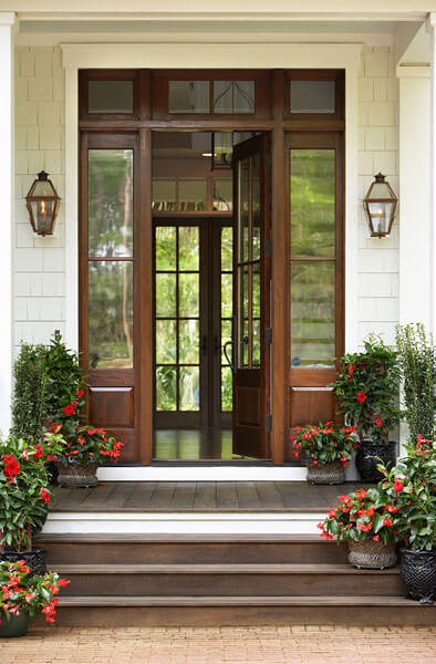 Front door is welcoming, with surrounding windows, a feature prominent throughout the home. Natural light and gorgeous views are a major part of the appeal.