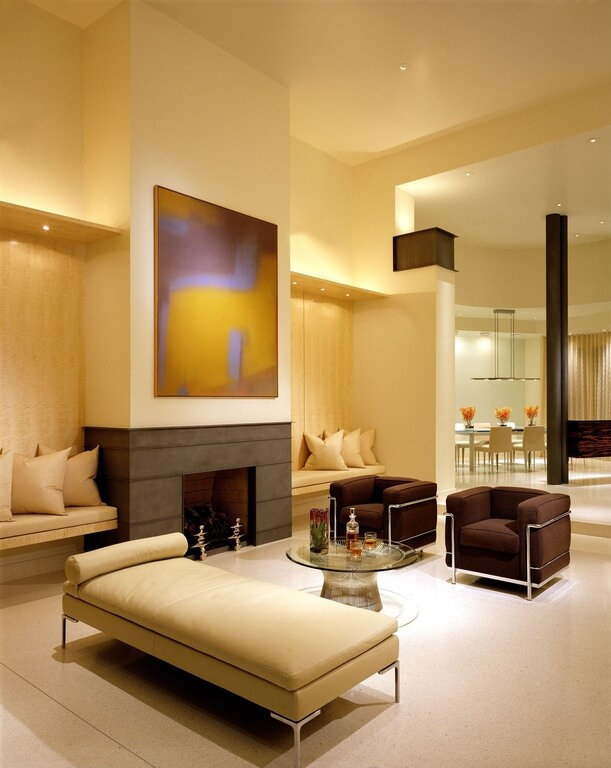 Warm Lighting Makes This Modern Beige Living Room Inviting With A Pair Of Contemporary Chocolate