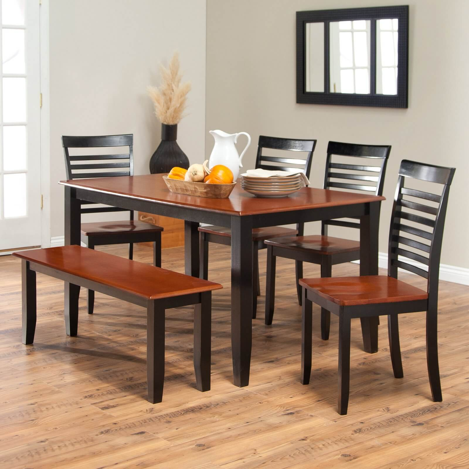 Simple two toned dining set with bench The seats and table top are