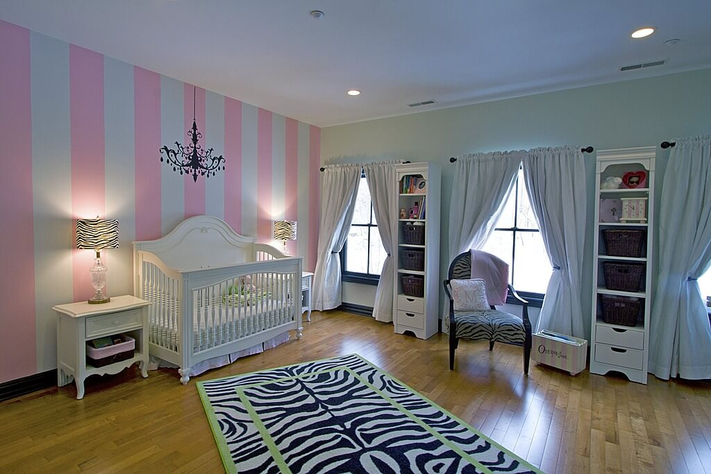 source zillow digs heres a girls baby nursery incorporating zebra print with a rectangle area rug running at an - Ideas For Bedroom Decorating Themes