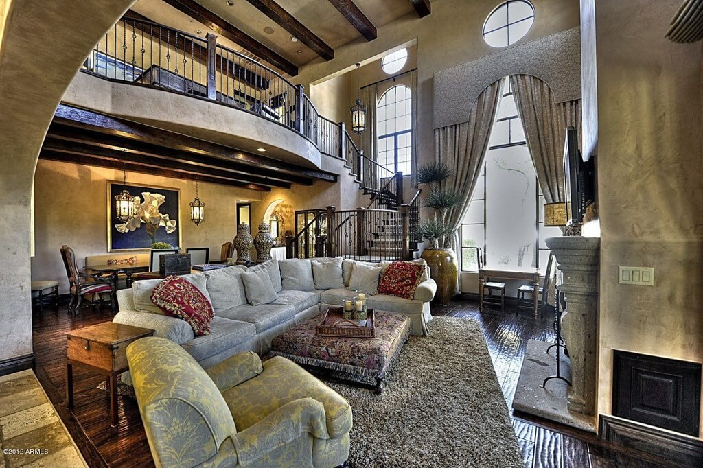 Lavish Detail Abounds In This Stately Living Room From Enormous Drapes Over The Two Story