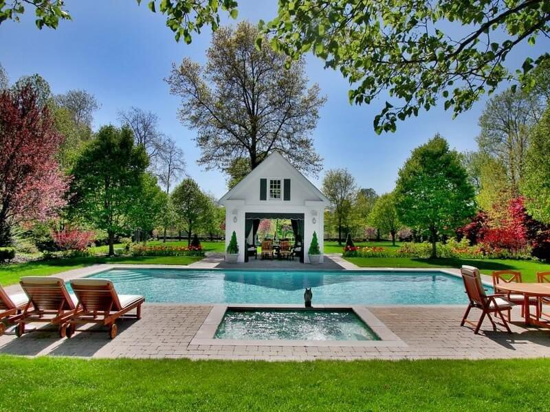 Traditional pools like this one sound unattractive, but they aren't. Many home owners with larger parcels of land create pool areas away from the home which creates an oasis in the middle of sprawling lawns. This is definitely a wonderful backyard gathering place.