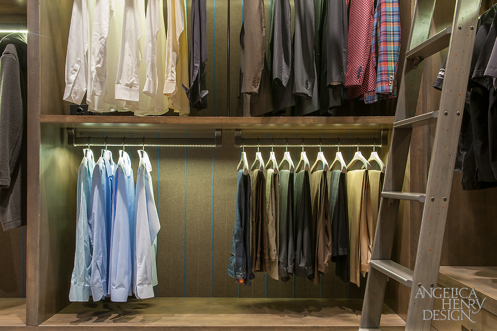 Close Up Of The Suit Rack In The Menu0027s Luxury Walk In Closet.