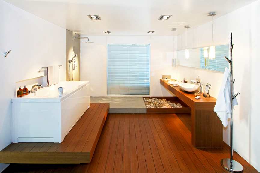 Striking Zen Style Informs This Bathroom With Lush Natural Wood Flooring And Raised Bath Platform