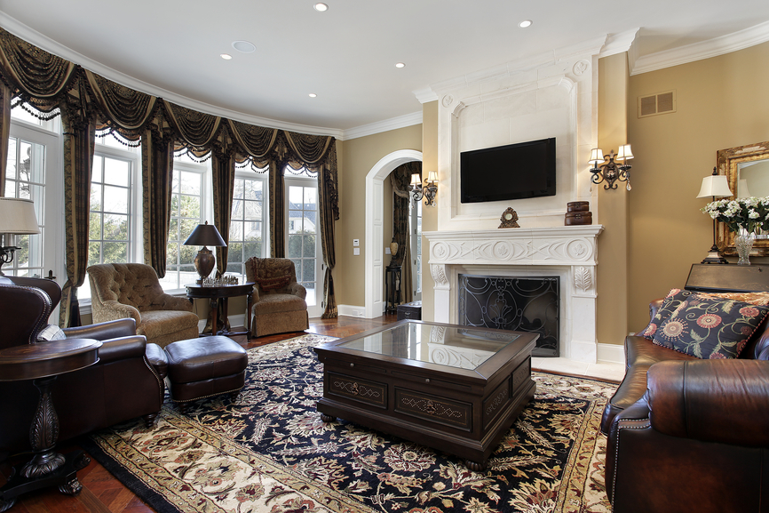 High Quality This Lavishly Appointed Living Room Spreads An Array Of Rich Leather And  Dark Plus Furniture Around