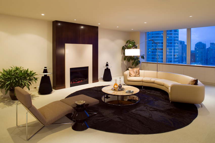 Ultra Modern Living Room In A High Rise Centers Around A Black Circular  Area Rug