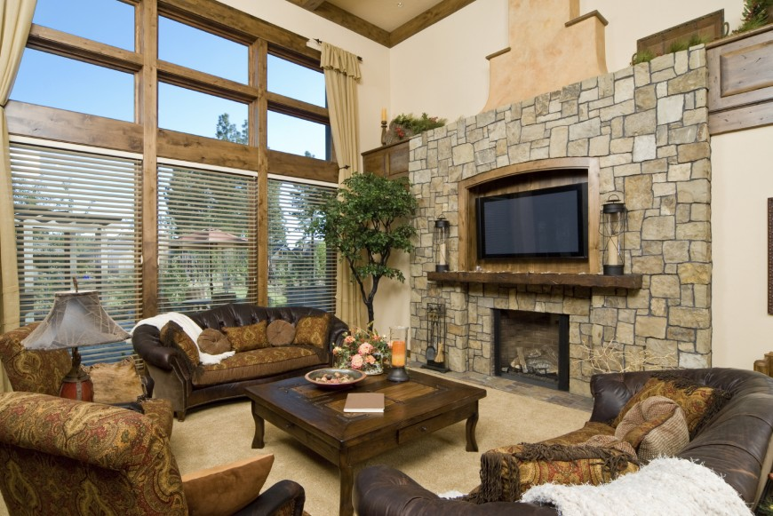 heres another luxurious rustic styled room wide stone fireplace surround includes wood mantle and
