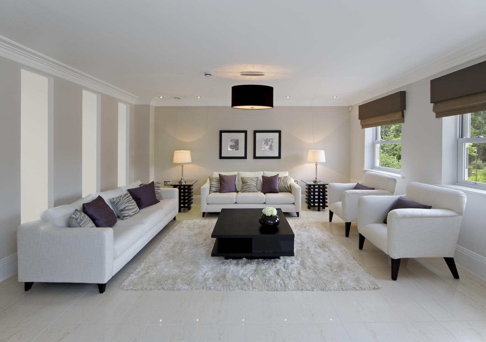 All white living room adds high contrast via central twotier jet