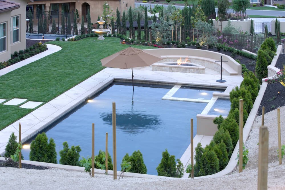Here's another example of a large pool, hot tub and patio complex in the backyard of a suburban home.1