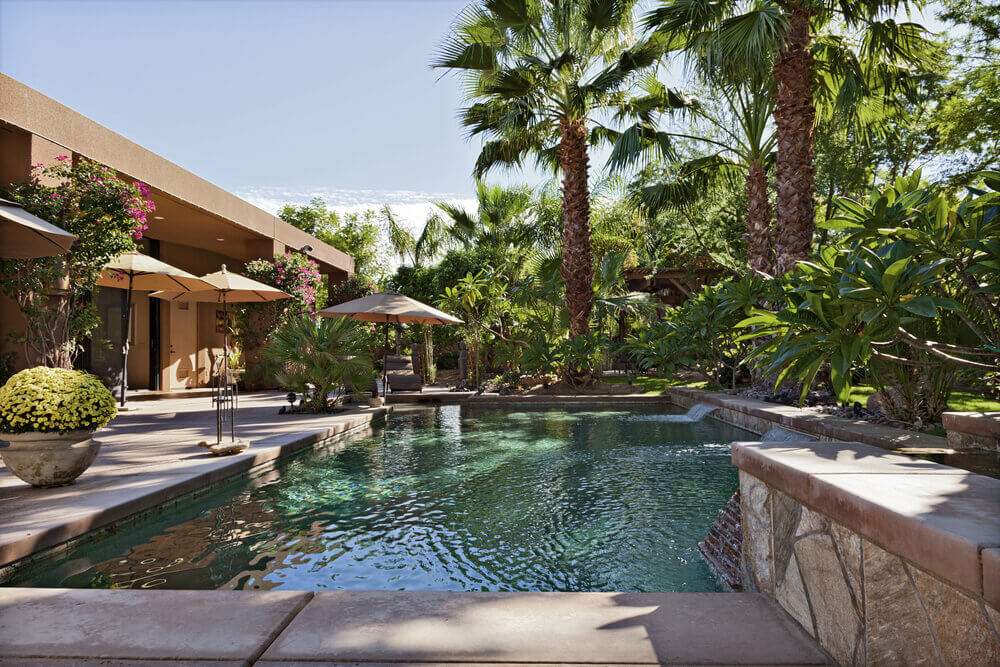 A backyard oasis with pool and patio