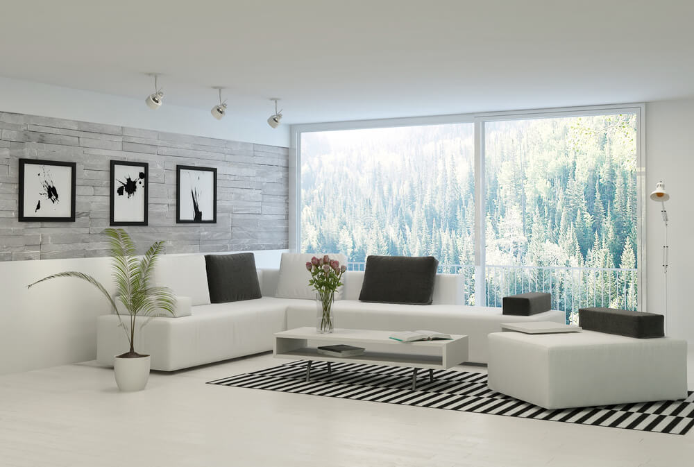 bright white living room with modern white sofas topped with charcoal