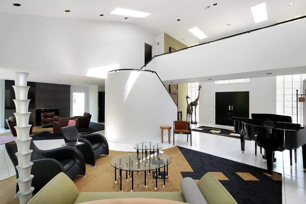 Ultra Luxurious Soaring Living Room In White Features A Catwalk Overlooking An Expanse Of