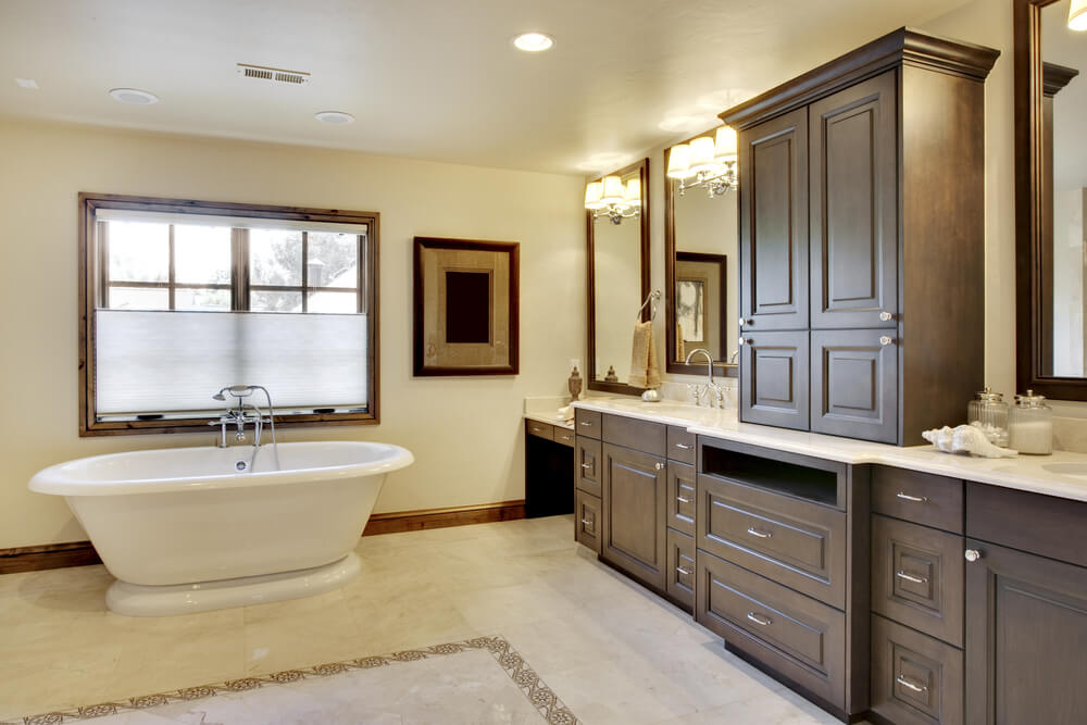 Large Bathroom Stands A White Pedestal Tub Across Expanse Of Patterned Tile  Flooring From Wall