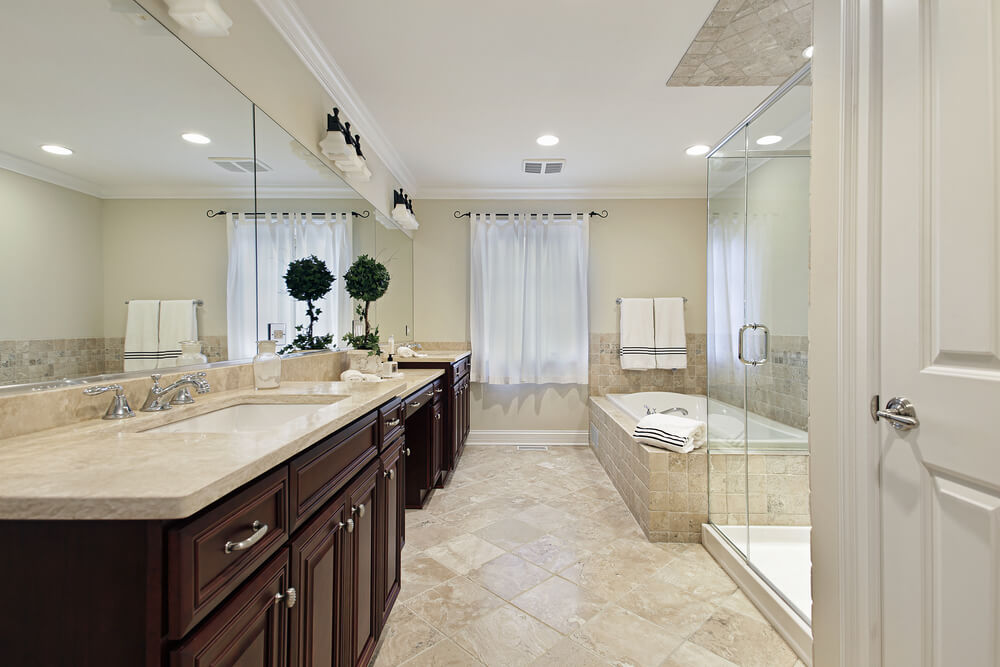Warm Swirled Beige Tile Fills The Lower Half Of This Expansive Bathroom Rich Dark Wood