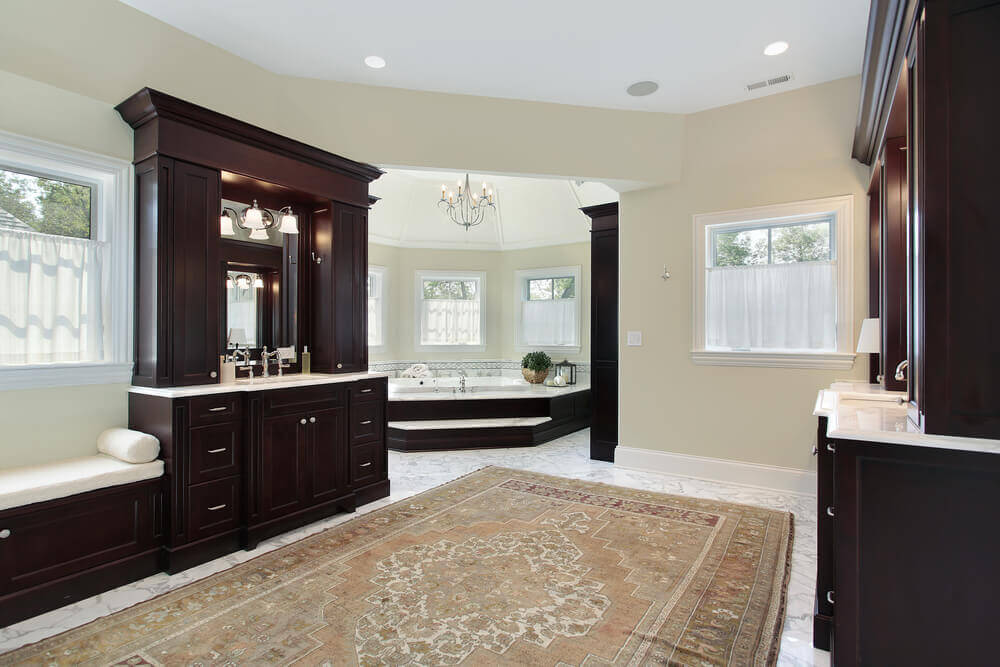 Spacious Luxury Master Bathroom With Extensive Custom Woodwork Throughout.