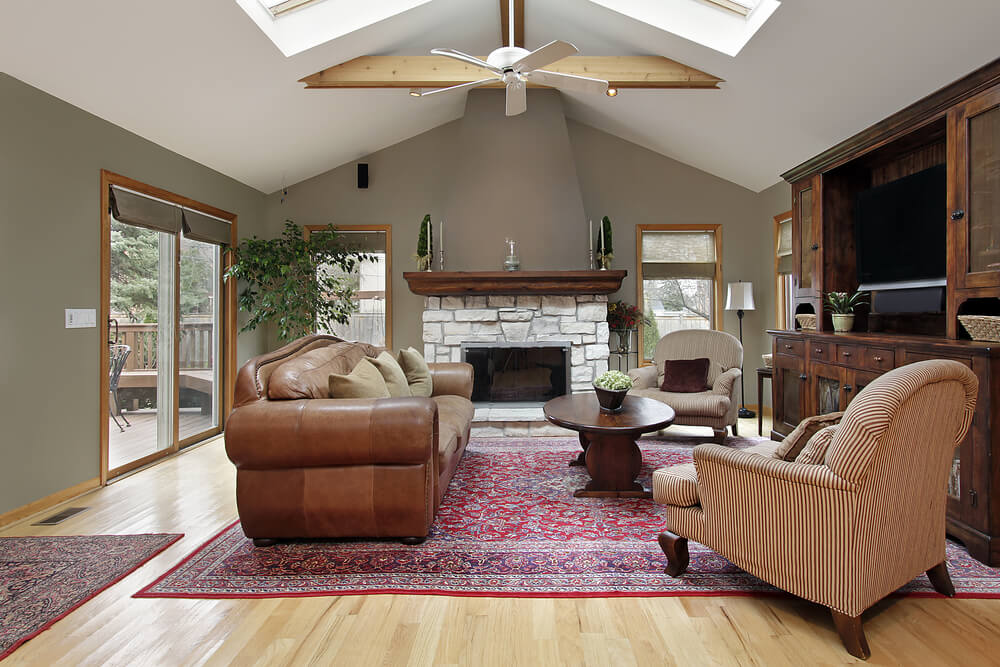 this sage colored living room with bright natural hardwood flooring