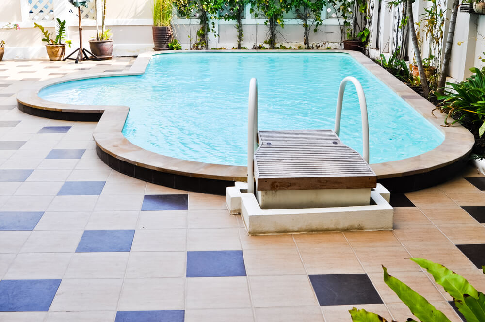 Here's another example of a fountain-style backyard pool. Again, not my favorite, but I do like the checked tile patio design.