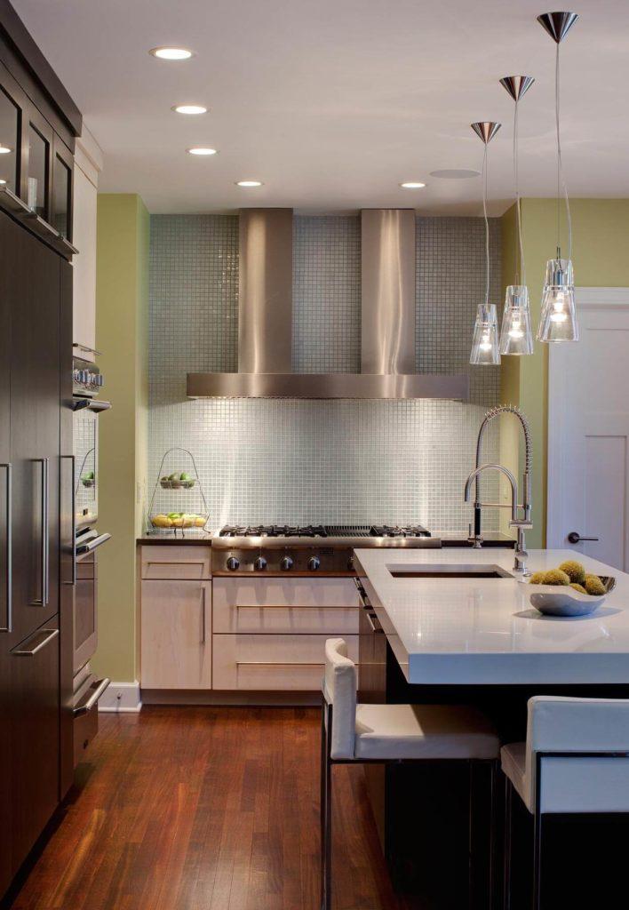 Soft light brightens up contemporary kitchen by drury design for Contemporary kitchen island lighting