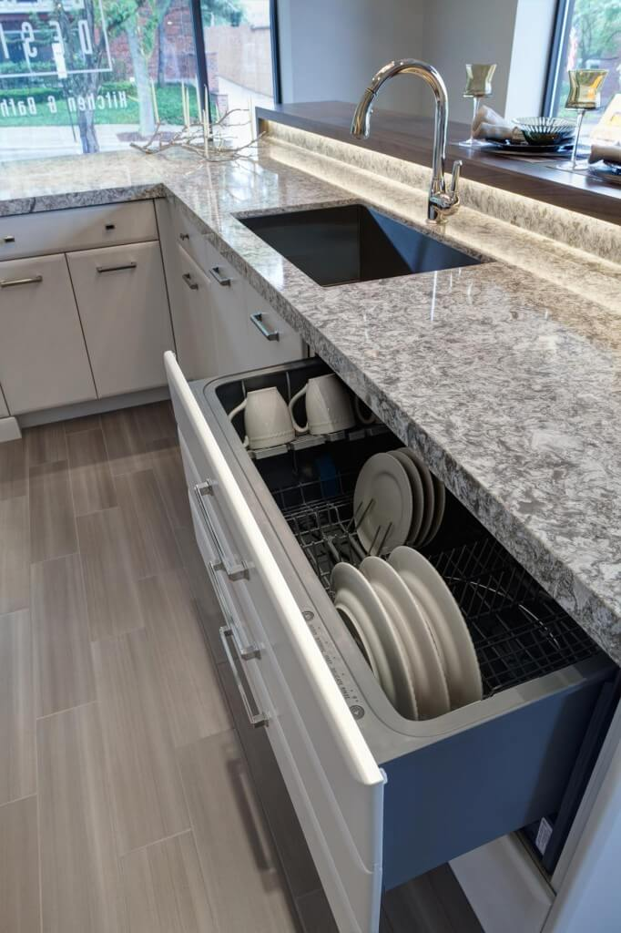 The fully concealed, extra large dish drawer sits within the island.