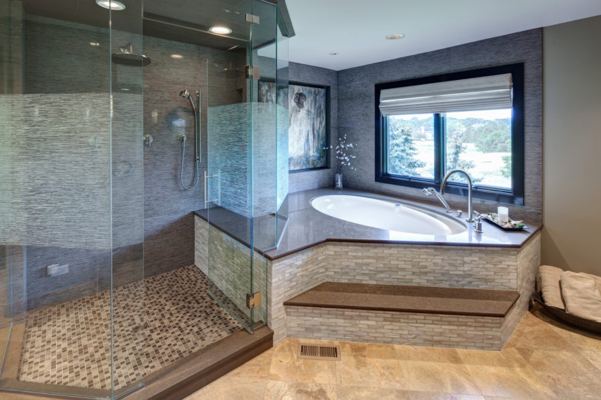 spacious master bathroom with step up tub and glass shower. Black Bedroom Furniture Sets. Home Design Ideas