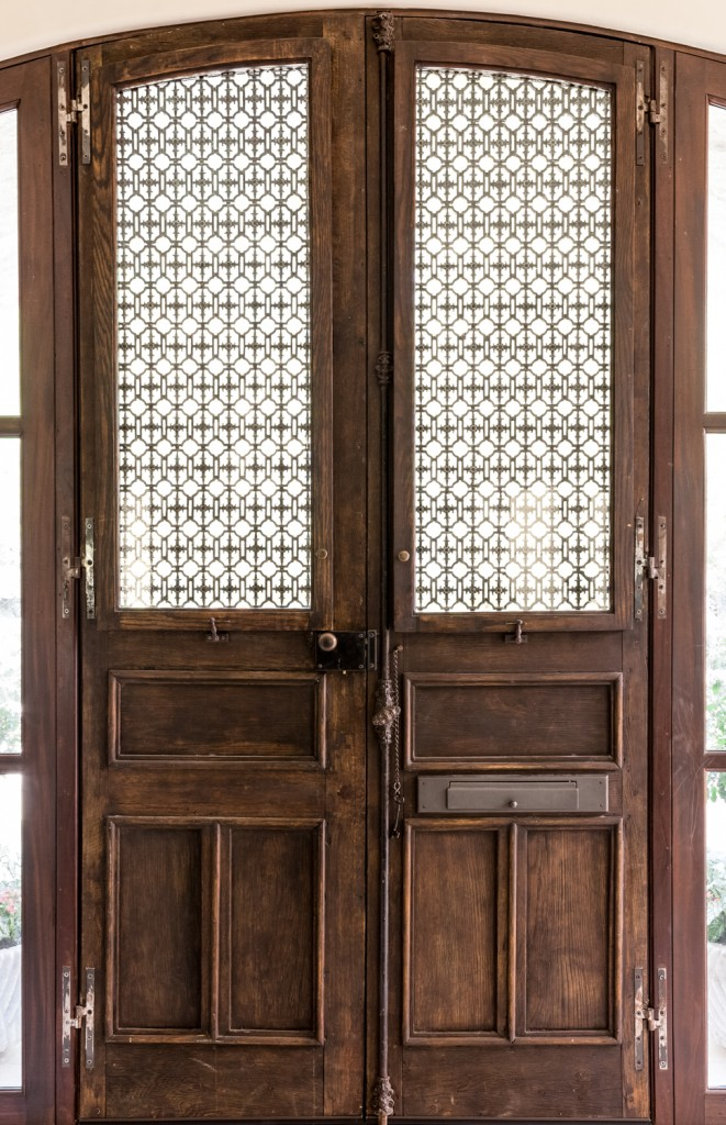 Here's a close view of the intricate, rustic look door. An abundance of hardware complements the leaded glass panels for a traditional luxury appearance.