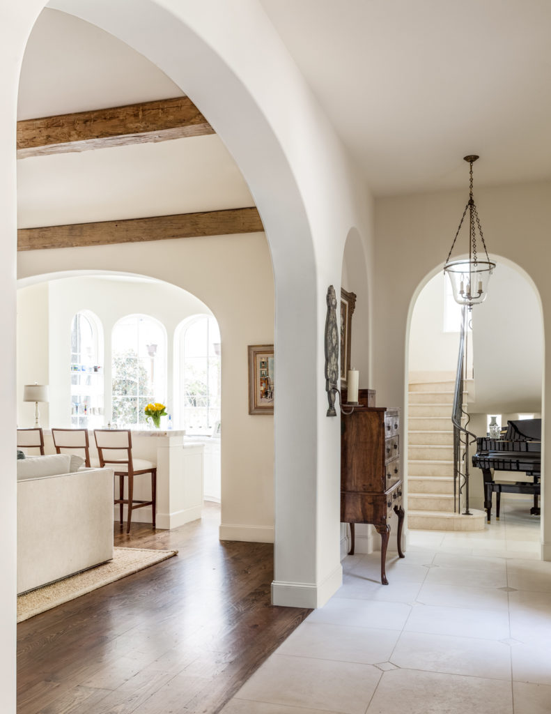 Returning to the entryway, we see the large open living room appearing at left, defined by hardwood flooring.