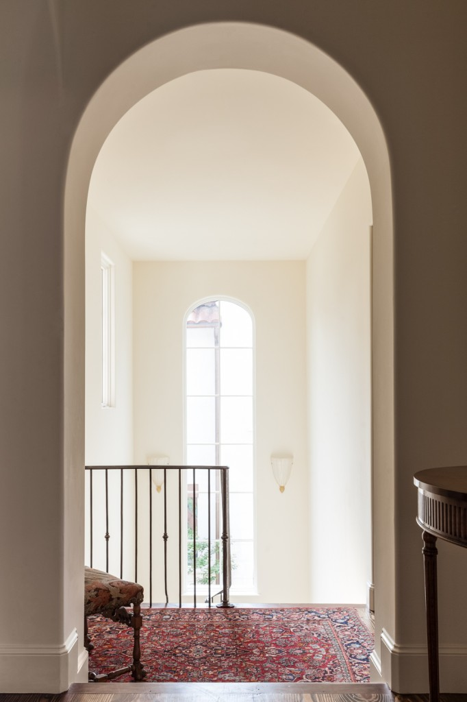 At the top of the main staircase, we see the massive two-story window opening up this area to the outdoors.