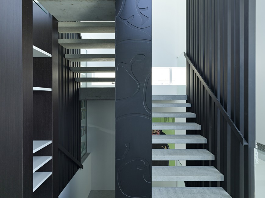 "The staircase features ""floating"" concrete step design for maximum visibility throughout."