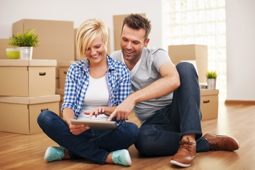 Couple researching furniture online in an empty house. 7 Ways to Finance Your Furniture Buying Spree  Pros   Cons